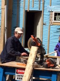 Chris works the chop saw